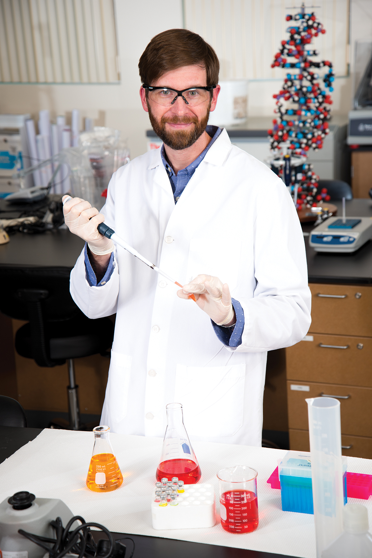 Cleary in the lab. He's now an assistant scientist at Somahlution, a Jupiter-based life science company.