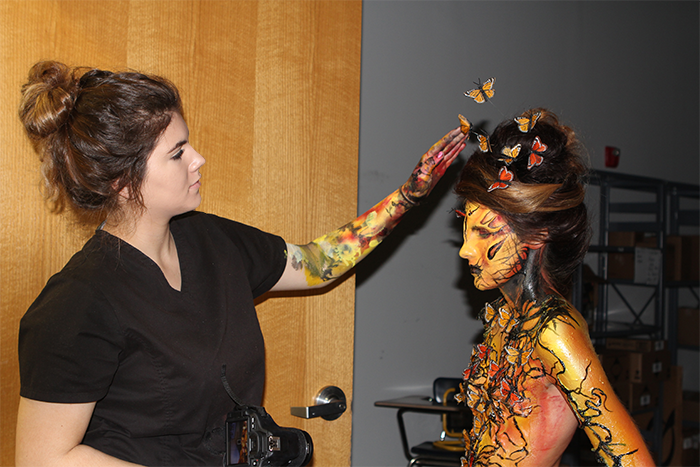 """Serpico puts finishing touches on Cosmetology classmate Samantha Krueger as """"Butterfly Girl""""—created as part of her audition portfolio for """"Face Off."""""""