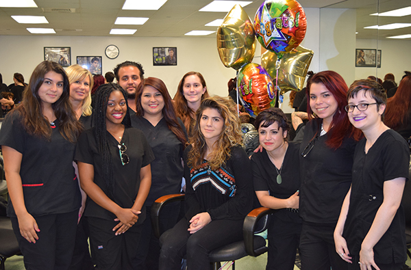 Emily Serpico (center/seated) and PBSC Cosmetology students