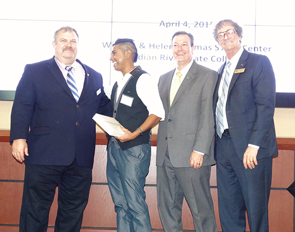 Tevin Ali (second from left) with (from left) Dr. Paul Horton, Indian River State College assistant dean; Dr. Anthony Iacono, IRSC vice president of academic affairs; and Dr. Harvey Arnold, IRSC Pruitt Campus Provost after being announced as first place winner for his oral presentation at the 2015 Life Sciences South Florida STEM Undergraduate Research Symposium on April 4.