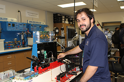 Pedro Paulo Borba, a student in the Electrical Power Technology program, tries out the new lab equipment.