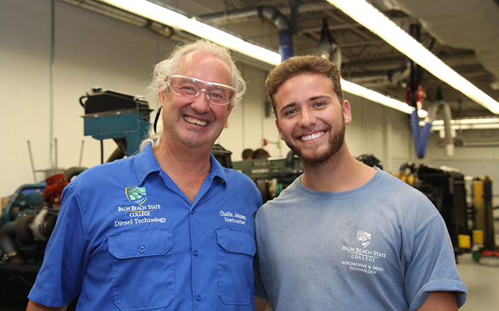 Instructor Charlie Johnson and scholarship winner Christopher Juez in the Diesel Technology lab on the Lake Worth campus