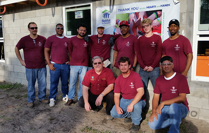 Electrician students at Habitat for Humanity of Palm Beach County home