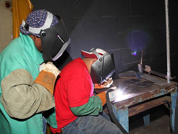 Welding students on Belle Glade campus