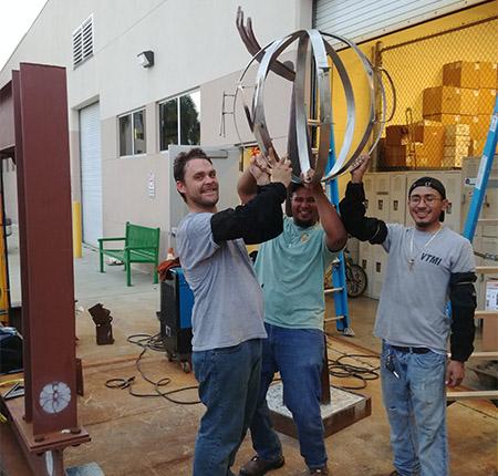 Welding Students with AVID Sculpture