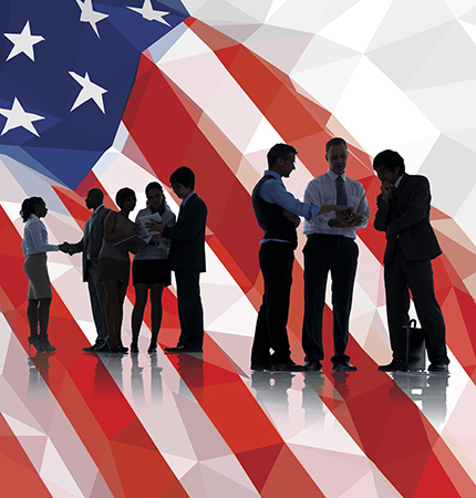 U.S. flag with silhouettes of business people